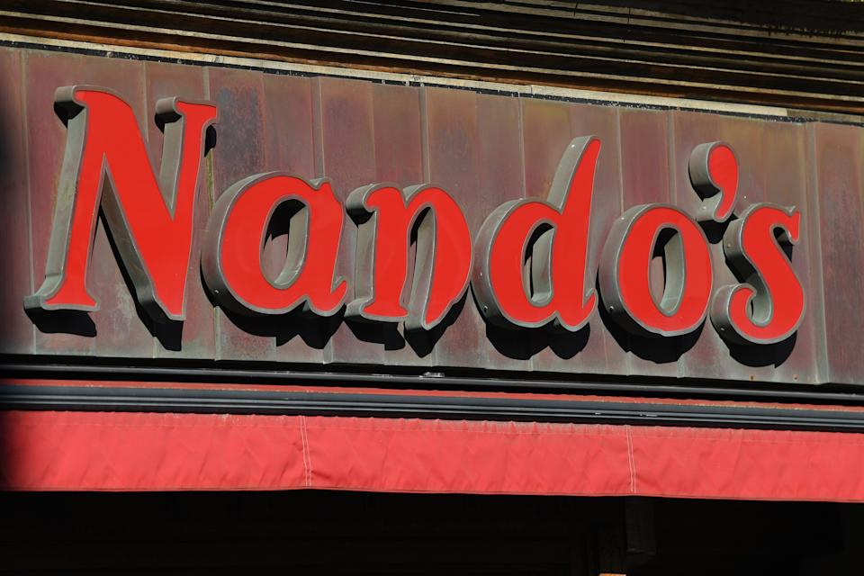 BRIGHTON,  - MARCH 23: The Nandos store is closed on March 23, 2020 in Brighton, England . McDonald's, Nando's and Costa Coffee were among the businesses who closed their UK stores this week due to the COVID-19 outbreak. Last week, the British government ordered all restaurants to close but exempted those offering take-out. Several closed nonetheless, citing the wellbeing of their employees and customers. (Photo by Mike Hewitt/Getty Images)