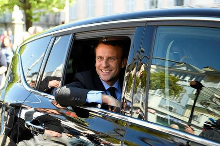Emmanuel Macron, head of the political movement En Marche ! ( Onwards !) and candidate for the 2017 presidential election, sits in his car during a campaign visit in Bagneres de Bigorre, France, April 12, 2017.   REUTERS/Eric Feferberg/Pool