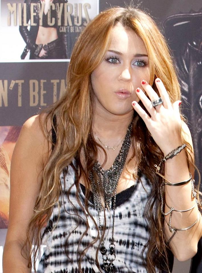 """Blogger Zack Taylor posted a story about a """"Miley Cyrus Sexting Photo,"""" featuring a picture of what appears to be the singer exposing her bare breasts and parts that are even more private. Taylor explains, """"Miley had her purse stolen at a party the other night (which contained her iPhone), and the person who took it is now leaking the nude photos online to various websites."""" For the naked truth about the racy photos, click over to <a href=""""http://www.gossipcop.com/miley-cyrus-naked-pic-sexting-nude-topless-pics-sext-photo-stolen-iphone/"""" target=""""new"""">Gossip Cop</a>. CordonPress/<a href=""""http://www.x17online.com"""" target=""""new"""">X17 Online</a> - May 31, 2010"""