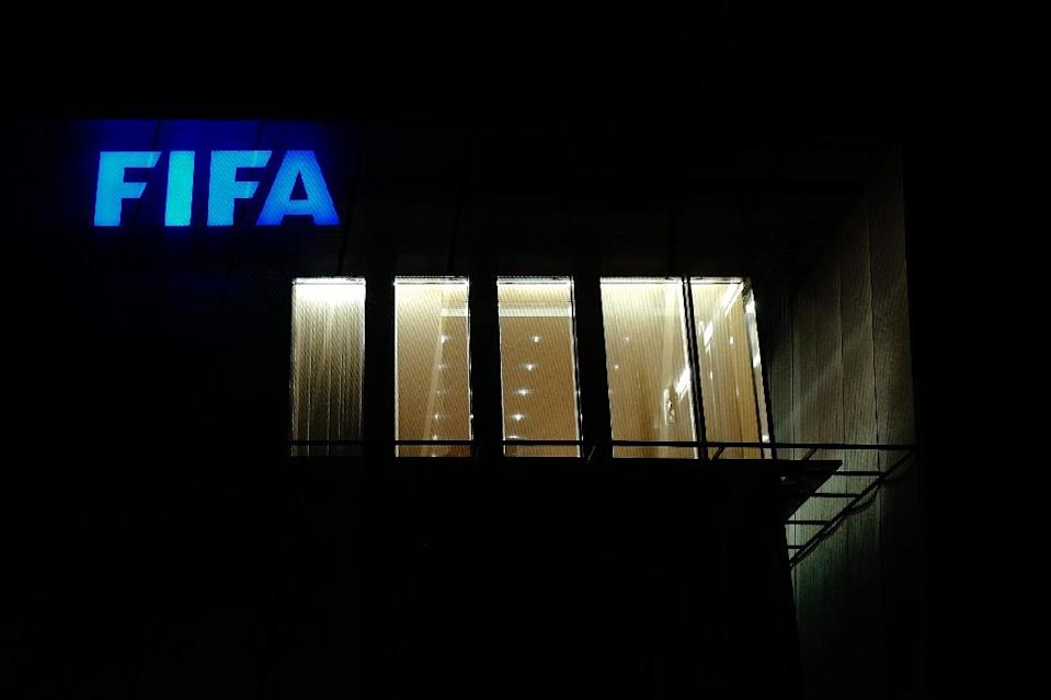 The decision to award Qatar football's highest-profile tournament ultimately sparked a wider fraud probe that led to the arrest of a series of senior FIFA figures (AFP Photo/FABRICE COFFRINI)