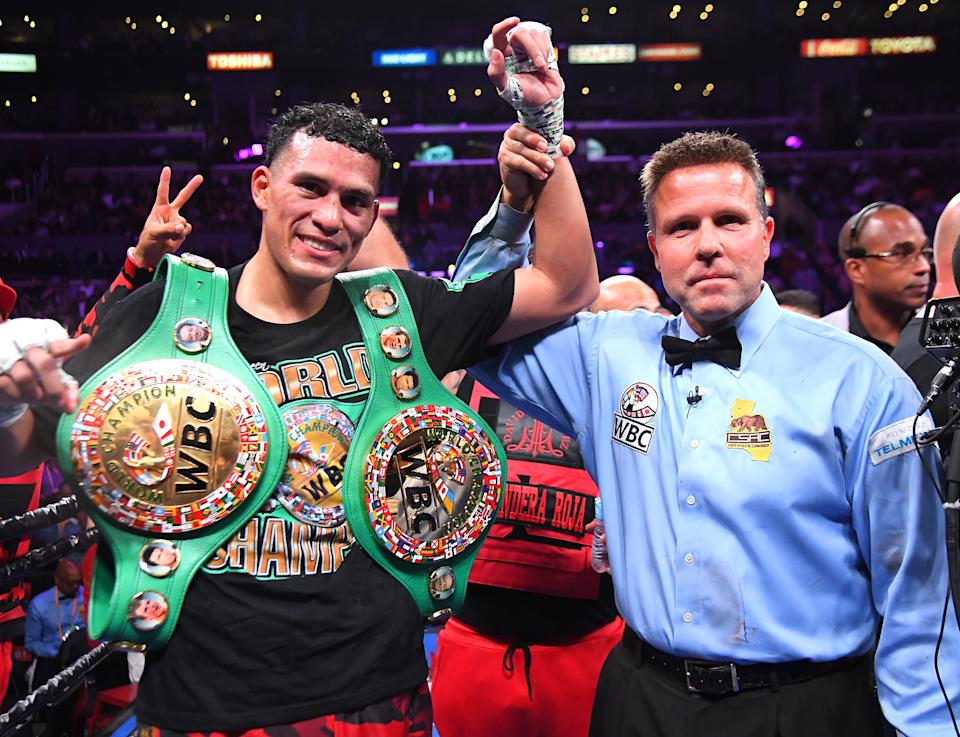 LOS ANGELES, CA - SEPTEMBER 28: Referee Thomas Taylor with David Benavidez in the ring after defeating Anthony Dirrell (not  pictured) after a corner stoppage in their WBC Super Middleweight Championship fight at Staples Center on September 28, 2019 in Los Angeles, California. (Photo by Jayne Kamin-Oncea/Getty Images)