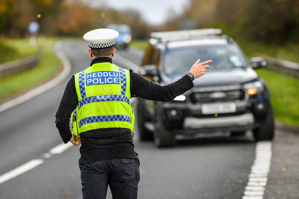 RETRANSMITTED CORRECTING SPELLING OF CARMARTHENSHIRE Welsh police pull over cars at a checkpoint during firebrake vehicle patrols close to the border between Carmarthenshire and Pembrokeshire, Wales. First Minister Mark Drakeford will unveil new national coronavirus measures for Wales on Monday.