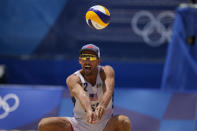 Nicholas Lucena, of the United States, competes during a men's beach volleyball match against Argentina at the 2020 Summer Olympics, Thursday, July 29, 2021, in Tokyo, Japan. (AP Photo/Petros Giannakouris)