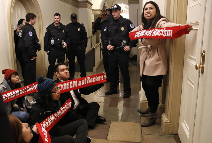 """<p>Diana Colin, right, with the Coalition for Humane Immigrant Rights (CHIRLA), shouts, """"McCarthy you have no heart,"""" as the group from California protests outside the office of House Majority Leader Kevin McCarthy of Calif., Thursday, Jan. 18, 2018, on Capitol Hill in Washington, in favor of the Deferred Action for Childhood Arrivals (DACA) program. Several members of the group were arrested by Capitol Police. (Photo: Jacquelyn Martin/AP) </p>"""