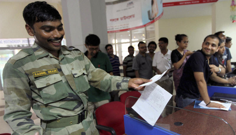 An Indian army soldier reacts as he prepares to send a telegram on the last day of the 163-year-old service at a telegraph office in Kolkata, India, Sunday, July 14, 2013. Sunday night, the state-run telecommunications company will send its final telegram, closing down a service that fast became a relic in an age of email, reliable landlines and ubiquitous cellphones. (AP Photo) INDIA OUT