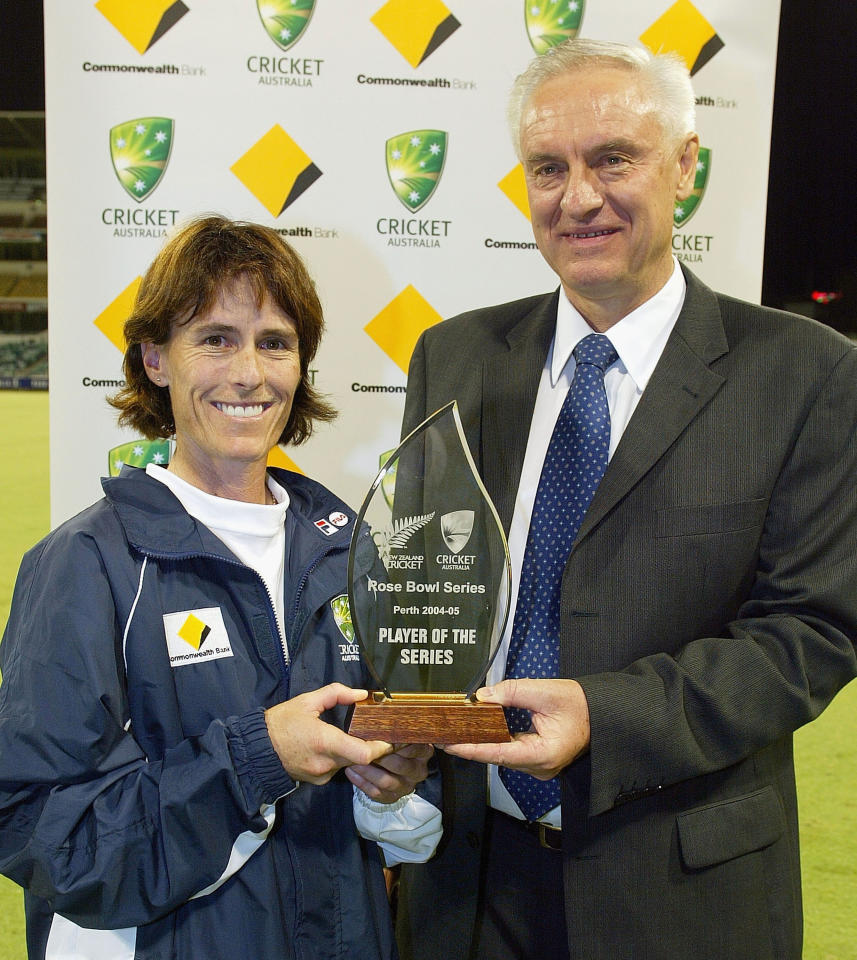 PERTH, AUSTRALIA - MARCH 13:  Player of the series Belinda Clark with Wally Edwards at the conclusion of the 3rd International Women's Rose Bowl match between Australia and New Zealand at the WACA on March 13, 2005 in Perth, Australia.  (Photo by Paul Kane/Getty Images)