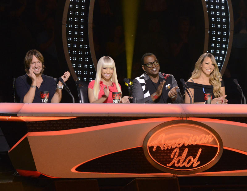 "This undated image released by Fox shows judges, from left, Keith Urban, Nicki Minaj, Randy Jackson and Mariah Carey from the singing competition series, ""American Idol,"" airing wednesdays and Thursdays on Fox. In its 12th season, ""American Idol"" is managing to hit the right notes with sponsors if not always with fickle viewers. It has retained its status as TV's advertising leader among series and the loyalty of its biggest backers, including Ford and Coca-Cola. (AP Photo/Fox, Michael Becker)"