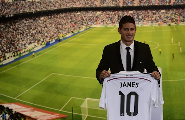 Colombian striker formerly at AS Monaco James Rodriguez poses during his presentation at the Santiago Bernabeu stadium following his signing with Spanish club Real Madrid in Madrid on July 22, 2014 (AFP Photo/Pierre-Philippe Marcou)
