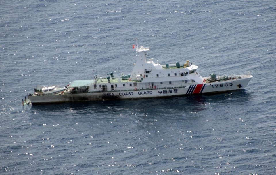 An image released by the Japan coast guard of a Chinese vessel cruising near the Senkaku islands in August 2021