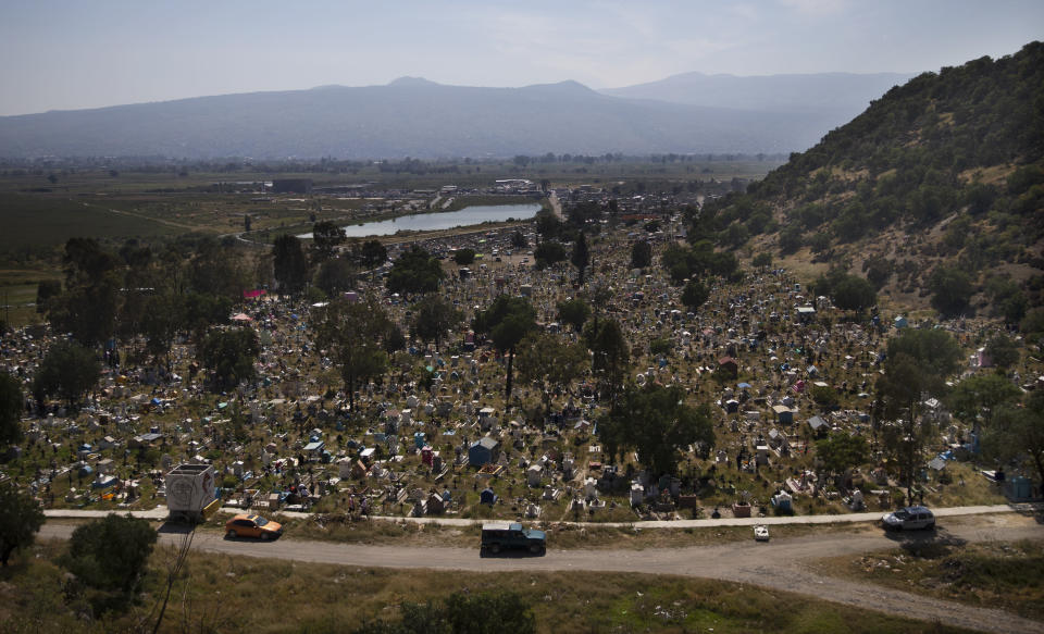 "Graves are decorated with crosses and grass in a section of the municipal cemetery Valle de Chalco amid the new coronavirus pandemic, on the outskirts of Mexico City, Sunday, Oct. 25, 2020. Mexican families traditionally flock to local cemeteries to honor their dead relatives as part of the ""Dia de los Muertos,"" or Day of the Dead celebrations, but according to authorities the cemeteries will be closed this year to help curb the spread of COVID-19. (AP Photo/Marco Ugarte)"