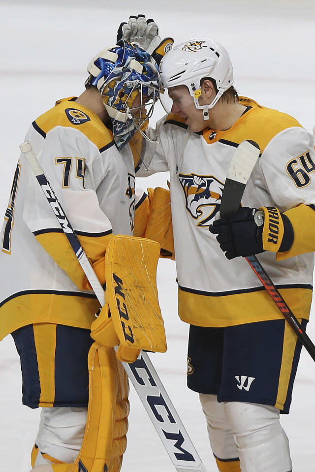 Nashville Predators' Mikael Granlund celebrates with goalie Juuse Saros after their team won 3-2 in a shootout against the Minnesota Wild during an NHL hockey game Sunday, March 3, 2019, in St. Paul, Minn. (AP Photo/Stacy Bengs)