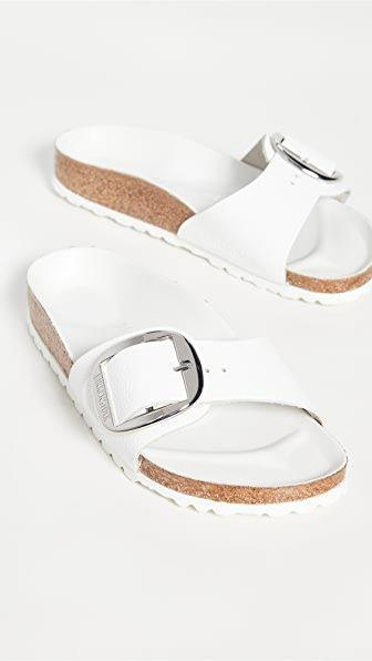"""<p><strong>Birkenstock</strong></p><p>shopbop.com</p><p><strong>$130.00</strong></p><p><a href=""""https://go.redirectingat.com?id=74968X1596630&url=https%3A%2F%2Fwww.shopbop.com%2Fmadrid-big-buckle-sandals-birkenstock%2Fvp%2Fv%3D1%2F1525126276.htm&sref=https%3A%2F%2Fwww.townandcountrymag.com%2Fstyle%2Ffashion-trends%2Fg36384322%2Fbest-sandals-for-women%2F"""" rel=""""nofollow noopener"""" target=""""_blank"""" data-ylk=""""slk:Shop Now"""" class=""""link rapid-noclick-resp"""">Shop Now</a></p><p>Perhaps the most divisive sandal style, these white sandals are an ideal summer update for dedicated Birkenstock fans.</p>"""