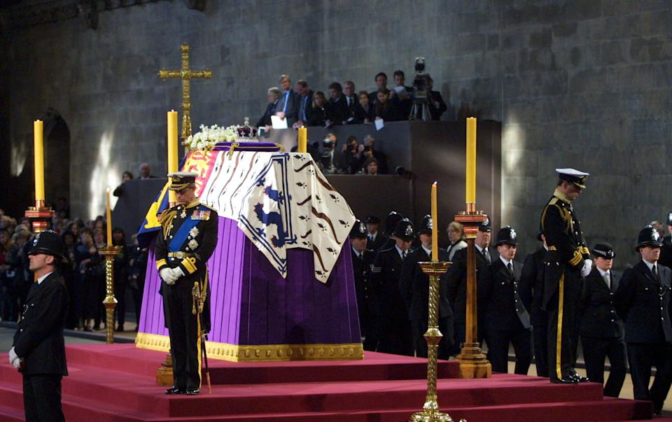 LONDON, UNITED KINGDOM:  Prince Charles (C) and the Duke of York (R) stand vigil beside the Queen Mother's coffin while it lies-in-state at Westminster Hall in London 08 April 2002. The funeral ceremony will be held at Westminster Abbey 09 April. AFP PHOTO Adrian DENNIS WPA POOL (Photo credit should read ADRIAN DENNIS/AFP via Getty Images)