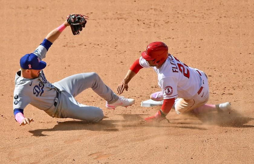 ANAHEIM, CALIFORNIA MAY 9, 2021-Dodgers 2nd baseman Gavin Lux can't catch the relay throw to 2nd base.