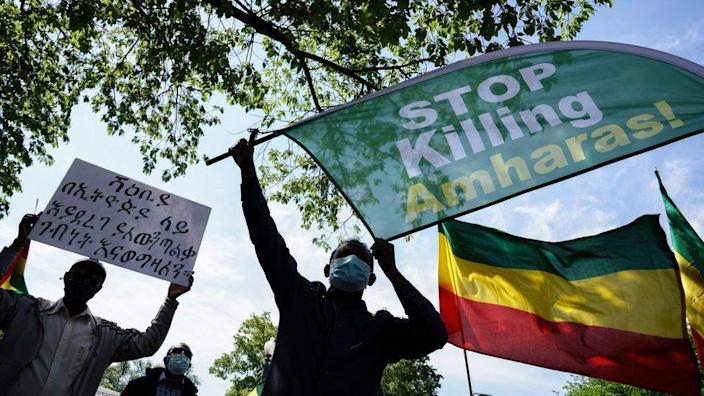 Members of the Ethiopian community hold up signs at the US State Department to protest the ongoing murder and ethnic cleansing of members of the Amhara ethnicity in multiple regions in Ethiopia at the U.S. State Department on May 17, 2021 in Washington, DC.