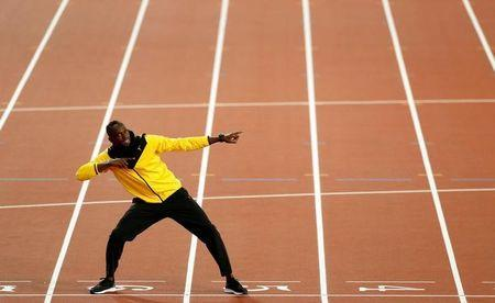 Usain Bolt of Jamaica poses during a lap of honour. REUTERS/John Sibley