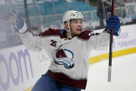 Colorado Avalanche left wing Andre Burakovsky celebrates after scoring during overtime of an NHL hockey game against the San Jose Sharks in San Jose, Calif., Monday, May 3, 2021. The Avalanche won, 5-4. (AP Photo/Jeff Chiu)