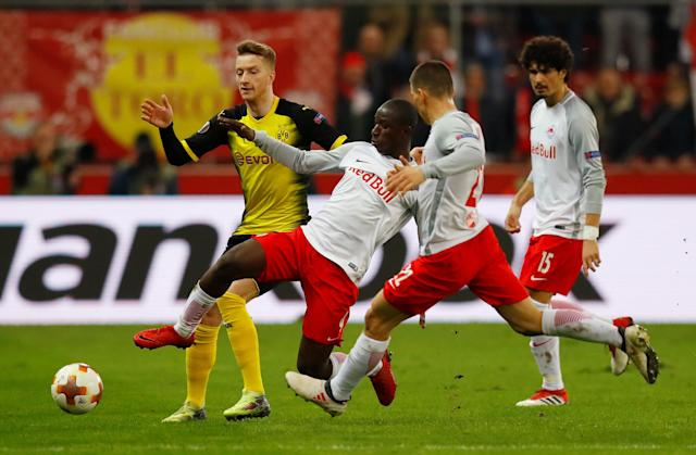 Soccer Football - Europa League Round of 16 Second Leg - RB Salzburg vs Borussia Dortmund - Red Bull Arena Salzburg, Salzburg, Austria - March 15, 2018 Borussia Dortmund's Marco Reus RB Salzburg's Amadou Haidara REUTERS/Leonhard Foeger