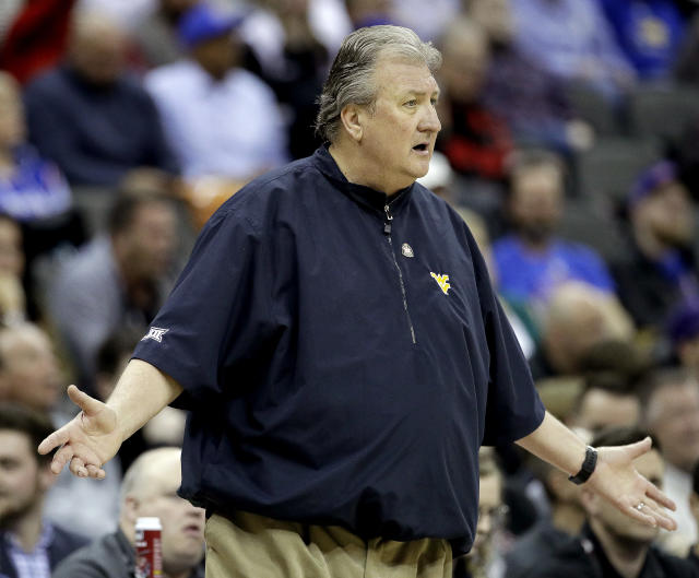 West Virginia head coach Bob Huggins questions a call during the first half of an NCAA college basketball game against Texas Tech in the Big 12 men's tournament Thursday, March 14, 2019, in Kansas City, Mo. (AP Photo/Charlie Riedel)
