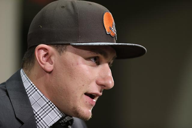 Cleveland Browns quarterback Johnny Manziel answers questions at his introductory news conference at the NFL football team's facility in Berea, Ohio Friday, May 9, 2014. Cleveland Browns quarterback Johnny Manziel, from Texas A&M, answers questions at his introductory news conference at the NFL football team's facility in Berea, Ohio Friday, May 9, 2014. The Browns selected Manziel 22nd overall in the first round in Thursday's NFL draft, after taking Oklahoma State cornerback Justin Gilbert with the eighth pick. (AP Photo/Mark Duncan)(AP Photo/Tony Dejak)