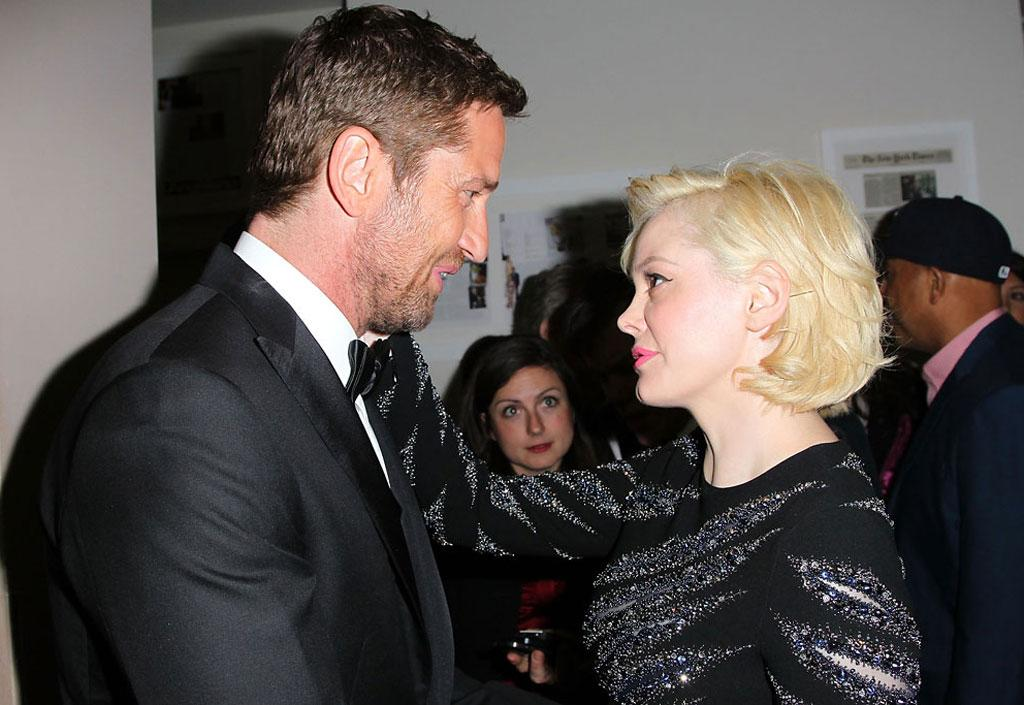 Gerard Butler and Rose McGowan attend the Hollywood Domino And Bovet 1822 Gala Benefiting Artists For Peace And Justice at Sunset Tower on February 21, 2013 in West Hollywood, California.