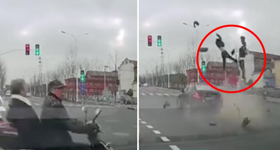 The scooter driver ignores traffic signals before he and his wife are struck by a passing car. Source: The Paper via Weibo