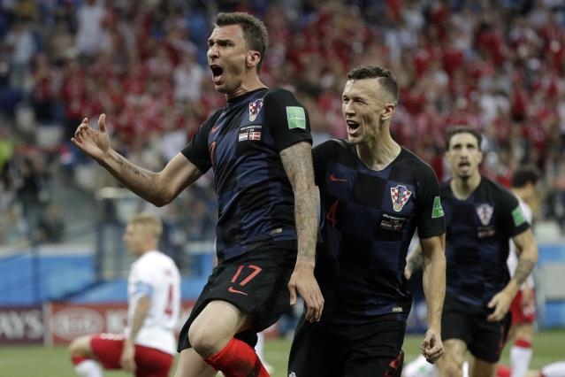 Croatia's Mario Mandzukic, left, celebrates with his teammates after scoring the opening goal of his team during the round of 16 match between Croatia and Denmark at the 2018 soccer World Cup in the Nizhny Novgorod Stadium, in Nizhny Novgorod, Russia, Saturday, July 1, 2018. (AP Photo/Gregorio Borgia)