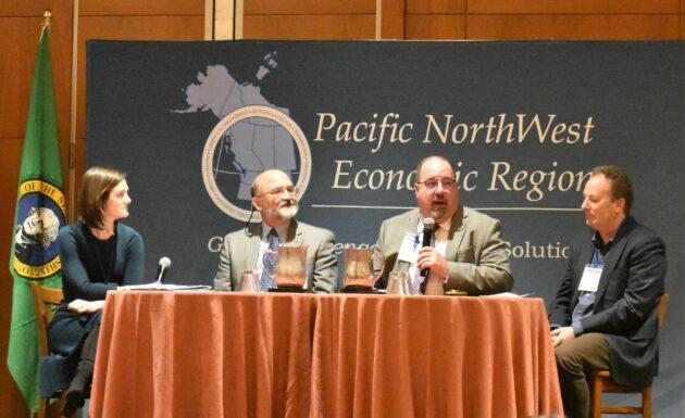 Emily Wittman, president and CEO of the Aerospace Futures Alliance and Washington State Space Coalition, discusses the Pacific Northwest's emerging space cluster with longtime aerospace executive Roger Myers, Aerojet Rocketdyne's Ken Young and Spaceflight's Curt Blake. (GeekWire Photo / Alan Boyle)