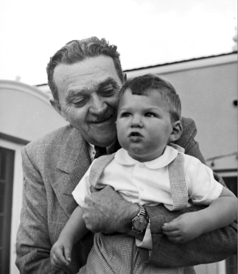 """This 1952 photo shows Billy Wilkerson with his son, Willie. The son of Hollywood Reporter founder Billy Wilkerson, W.R. Wilkerson III, is apologizing for his father's and the trade paper's role in the 1947 Hollywood Blacklist that destroyed the careers of writers, actors and directors accused of having Communist ties. He offers his """"sincerest apologies and deepest regrets to those who were victimized by this unfortunate incident."""" (AP Photo/Wilkerson Archives, Alex Paal)"""