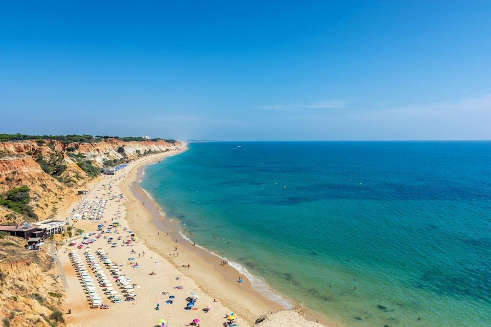 <p>Falesia is one of the longest beaches in Portugal, backed by beautiful cliffs covered in pine trees and accessed by steps that lead down from a clifftop car park. </p>