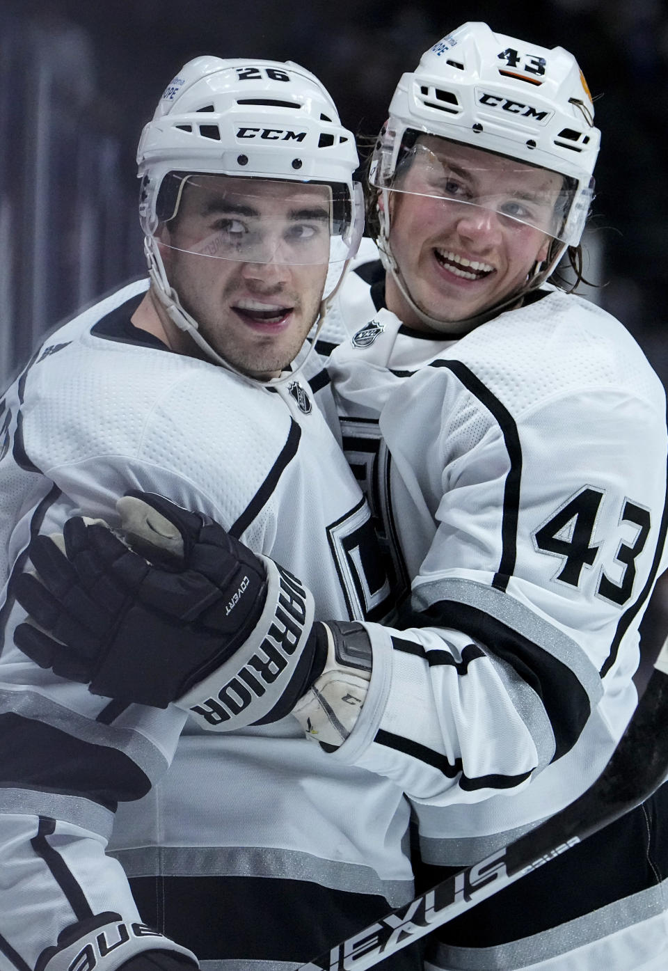 Los Angeles Kings defenseman Sean Walker (26) celebrates a goal with teammate Drake Rymsha (43) against the Colorado Avalanche during the first period of an NHL hockey game Thursday, May, 13, 2021, in Denver. (AP Photo/Jack Dempsey)