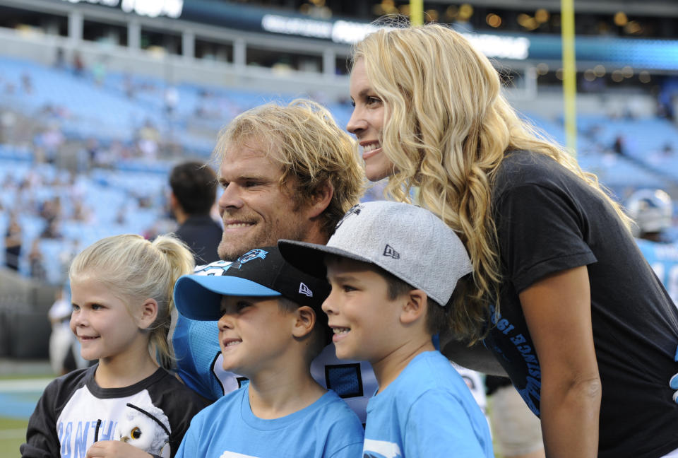 Carolina Panthers' Greg Olsen poses for a photo with his family before a preseason NFL football game against the New England Patriots in Charlotte, N.C., Friday, Aug. 24, 2018. (AP Photo/Mike McCarn)