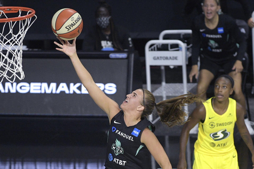 "New York Liberty forward Sabrina Ionescu goes up for a shot as Seattle Storm guard <a class=""link rapid-noclick-resp"" href=""/wnba/players/5316/"" data-ylk=""slk:Jewell Loyd"">Jewell Loyd</a>, right, watches during the second half of a WNBA basketball game, Saturday, July 25, 2020, in Ellenton, Fla. (AP Photo/Phelan M. Ebenhack)"
