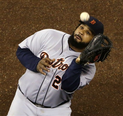 Detroit Tigers first baseman Prince Fielder catches a fly foul ball for an out on Kansas City Royals' Salvador Perez during the eighth inning of a baseball game Tuesday, Aug. 28, 2012, in Kansas City, Mo. (AP Photo/Charlie Riedel)