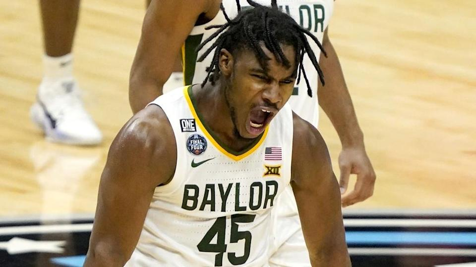 Baylor Bears guard Davion Mitchell (45) celebrates after sinking a buzzer beater three-pointer at the end of the first half against Houston during the semifinals of the Final Four of the 2021 NCAA Tournament on Saturday, April 3, 2021, at Lucas Oil Stadium in Indianapolis, Ind.