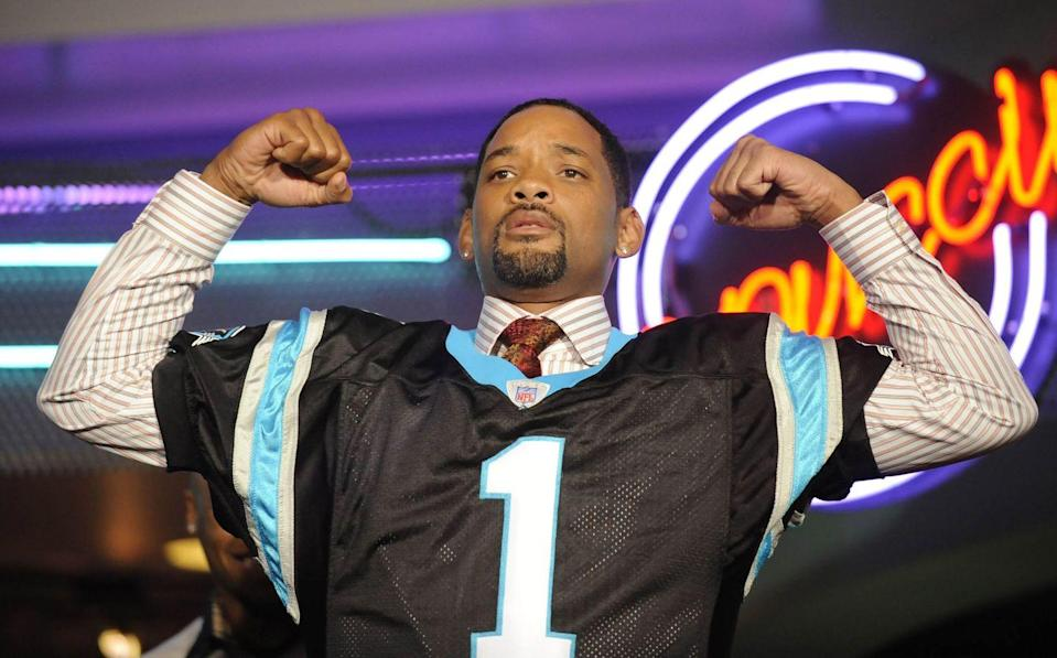 <p>Will Smith poses in a jersey given to him by NFL player Steve Smith of the Carolina Panthers during the premiere of <em>Seven Pounds</em>, with a canned food drive for Second Harvest Food Bank, at the Regal Stonecrest December 11, 2008 in Charlotte, North Carolina.</p>