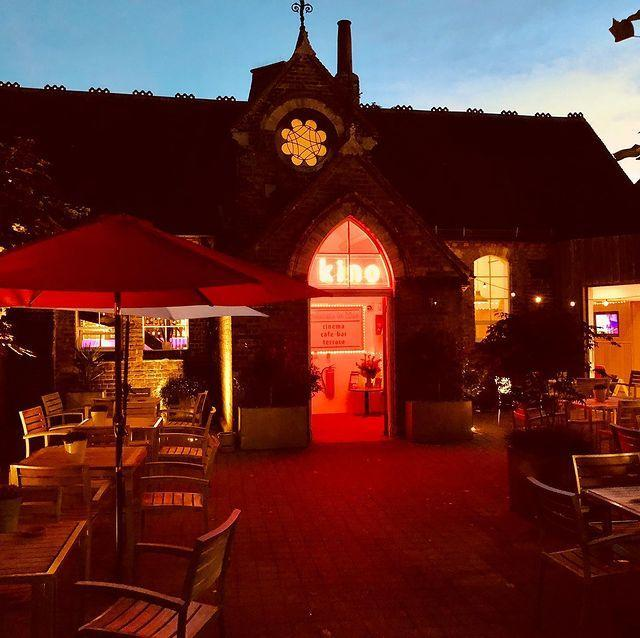 """<p>You might think a cinema's not the best place to get to know a new town, but the stylish Kino is a popular local spot. Sit yourself in the sunny outdoor terrace at sundown with a glass of crisp white wine or an Aperol spritz, where you can meet fellow film-goers and local punters.</p><p>When the night gets chillier, take your drink inside and cuddle up in front of a film. Food from local producers is also available - for something substantial try the deep-filled savoury tart.</p><p><a href=""""https://www.instagram.com/p/B-cR9Nlhbdn/"""" rel=""""nofollow noopener"""" target=""""_blank"""" data-ylk=""""slk:See the original post on Instagram"""" class=""""link rapid-noclick-resp"""">See the original post on Instagram</a></p>"""