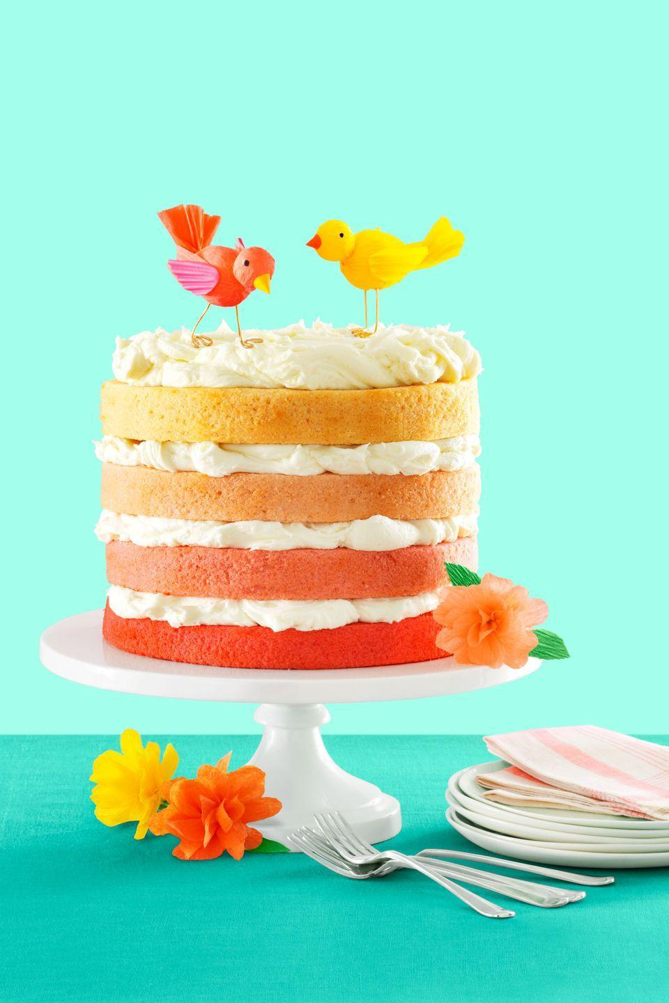 """<p>This colorful springtime confection is a showstopper.<br></p><p><a href=""""https://www.womansday.com/food-recipes/food-drinks/recipes/a54430/pink-ombre-cake-with-buttercream-recipe/"""" rel=""""nofollow noopener"""" target=""""_blank"""" data-ylk=""""slk:Get the recipe for Pink Ombré Cake with Vanilla Buttercream."""" class=""""link rapid-noclick-resp""""><em>Get the recipe for Pink Ombré Cake with Vanilla Buttercream. </em></a></p>"""