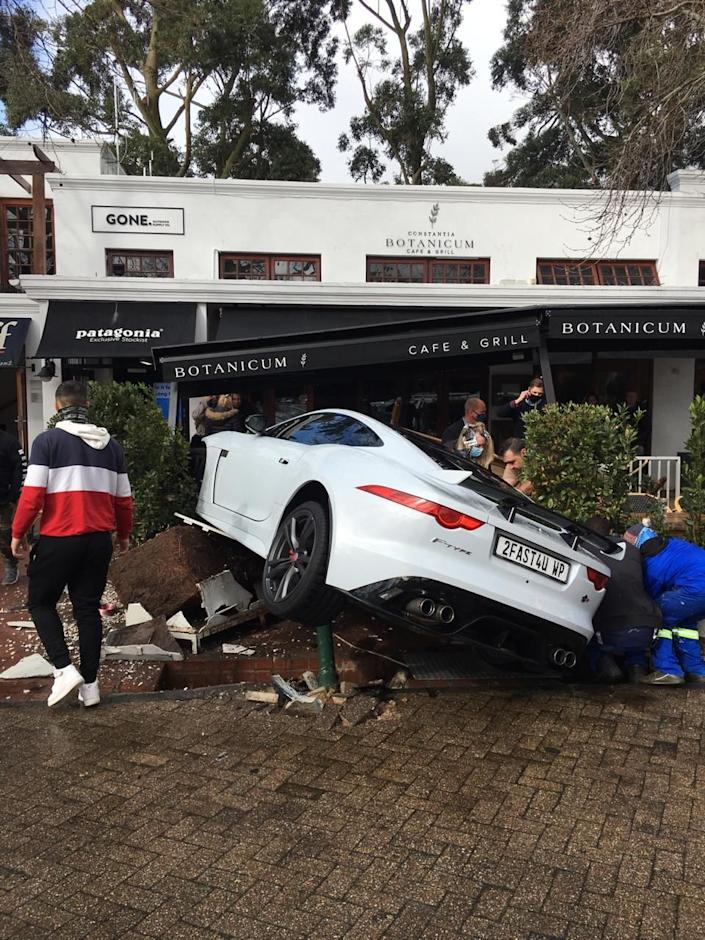 Diners had to scramble for safety as the Jaguar F-Type Coupe ploughed through safety barriers (Picture: SWNS)