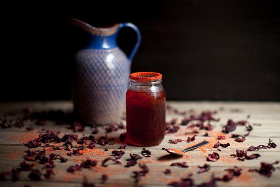 """<p>A little rosemary and worm salt or chili powder give this drink a nice kick to warm you up on the chilliest evenings. </p><p><strong>Ingredients: </strong></p><p>1½ oz. of <a href=""""http://mezcalunion.com/index_english.html"""" rel=""""nofollow noopener"""" target=""""_blank"""" data-ylk=""""slk:Mezcal Unión Joven"""" class=""""link rapid-noclick-resp"""">Mezcal Unión Joven<br></a>Dash of lime juice<br>Hibiscus water<br>Rosemary leaves<br>Chili powder</p><p><strong>Directions: </strong></p><p>Frost a glass rim with worm salt or chili powder. Pour Mezcal Unión Joven and the lime juice dash. Add the hibiscus water. Mix with a bar spoon. Garnish with rosemary leaves.</p>"""