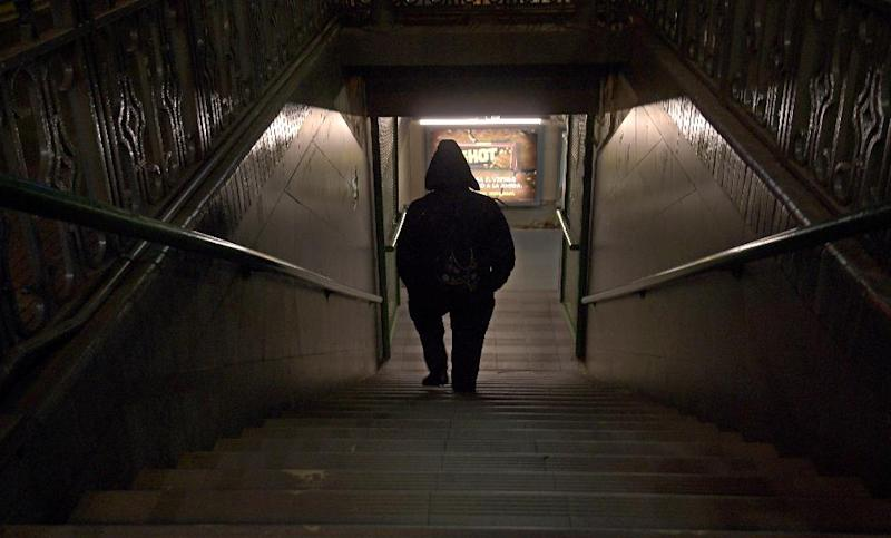 A man walks downstairs to take the subway in Buenos Aires on August 28, 2014, during the general strike in Argentina (AFP Photo/Daniel Garcia)