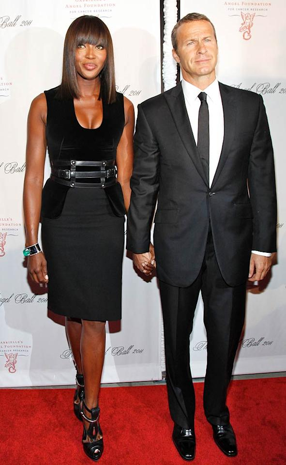 Naomi Campbell and her billionaire boyfriend, Vladislav Doronin, were honored at Tuesday's Angel Ball for raising over $7 million for Haiti relief. Doronin looked incredibly handsome in a sleek suit, while Campbell killed it in head-to-toe McQueen, including a harness belt. (10/17/11)