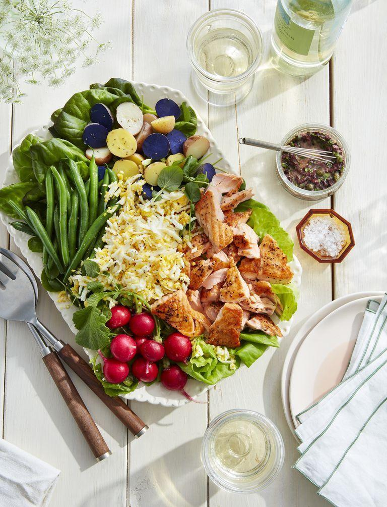 """<p><a href=""""https://www.countryliving.com/food-drinks/g1428/potato-salad-recipes/"""" rel=""""nofollow noopener"""" target=""""_blank"""" data-ylk=""""slk:Potato salad"""" class=""""link rapid-noclick-resp"""">Potato salad</a> is an absolute must when it comes to <a href=""""https://www.countryliving.com/food-drinks/g4381/summer-dinner-recipes/"""" rel=""""nofollow noopener"""" target=""""_blank"""" data-ylk=""""slk:summer dinners"""" class=""""link rapid-noclick-resp"""">summer dinners</a>. This loaded version is sure to impress your guests' eyes and taste buds. </p><p><strong><a href=""""https://www.countryliving.com/food-drinks/a26434198/seared-salmon-watercress-potato-salad-olive-dressing-recipe/"""" rel=""""nofollow noopener"""" target=""""_blank"""" data-ylk=""""slk:Get the recipe"""" class=""""link rapid-noclick-resp"""">Get the recipe</a>.</strong></p>"""