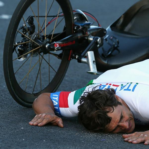 LONGFIELD, ENGLAND - SEPTEMBER 07: Alessandro Zanardi of Italy celebrates winning the Men's Individual H4 Road Race on day 9 of the London 2012 Paralympic Games at Brands Hatch on September 7, 2012 in Longfield, England. (Photo by Bryn Lennon/Getty Images)