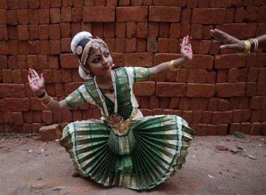 A school girl practices Bharatnatyam, an Indian classical dance, before a performance on the occasion of Mahashivratri festival in Thiruvananthapuram, Kerala February 20, 2012.