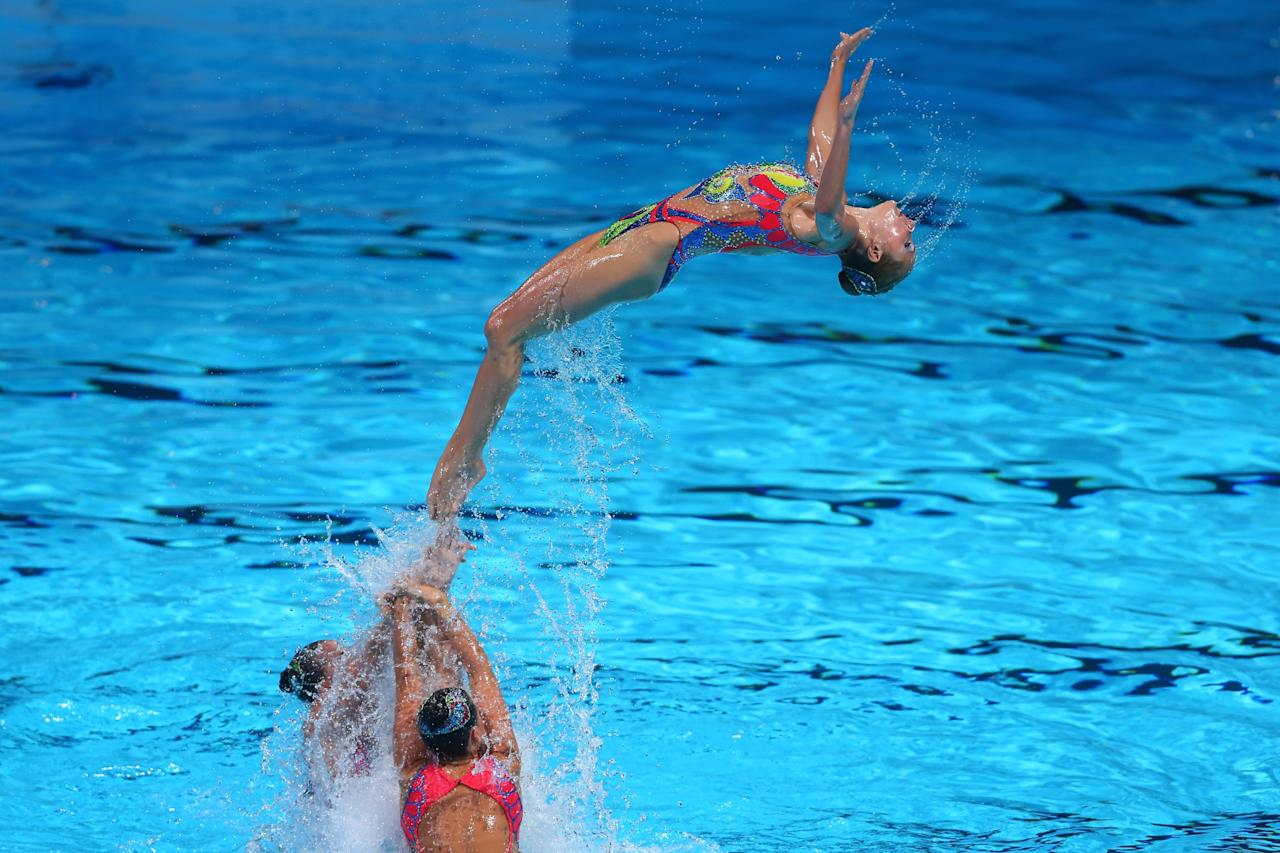 BARCELONA, SPAIN - JULY 23: Ukraine compete in the Synchronized Swimming Duet preliminary round on day four of the 15th FINA World Championships at Palau Sant Jordi on July 23, 2013 in Barcelona, Spain. (Photo by Alexander Hassenstein/Getty Images)