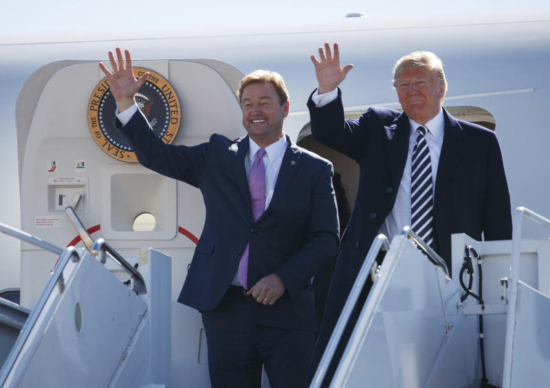 Sen. Dean Heller (R-Nev.) steps off Air Force One with President Donald Trump ahead of a rally in Elko, Nevada, on Saturday. (ASSOCIATED PRESS)