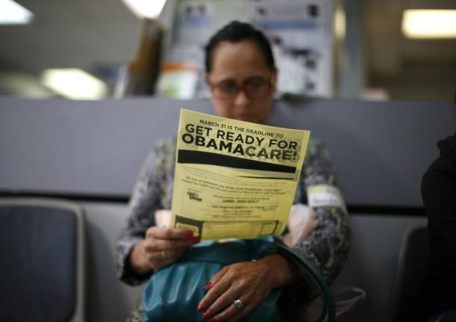 Arminda Murillo, 54, reads a leaflet on Obamacare at a health insurance enrollment event in Cudahy, California, U.S. March 27, 2014.</p> <p> REUTERS/Lucy Nicholson/File Photo