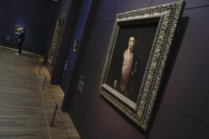 """Titian's Portrait of Ranuccio Farnese, painted in 1541-1542, on loan from the National Gallery of Art in Washington, is seen during a press preview of the Remember Me exhibit at the Rijksmuseum in Amsterdam, Netherlands, Tuesday, Sept. 28, 2021. As COVID-19 lockdowns ease and borders reopen, there is a gathering at Amsterdam's Rijksmuseum of people from around Europe, depicted in more than 100 Renaissance portraits. The Dutch national museum's new exhibition """"Remember Me,"""" covers the century 1470-1570. (AP Photo/Peter Dejong)"""