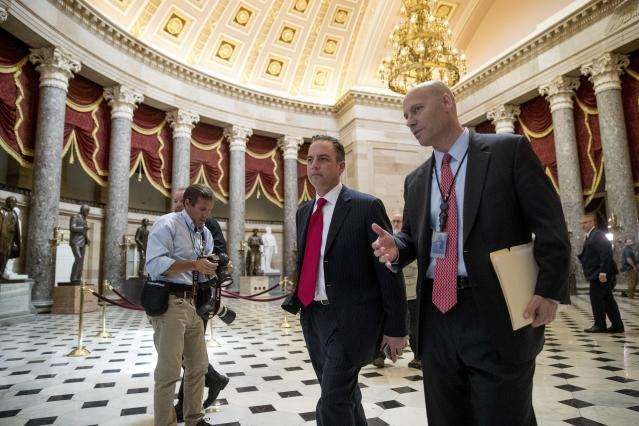 House OKs GOP health bill, a step toward Obamacare repeal. White House Chief of Staff Reince Priebus, center, walks near the House Chamber on Capitol Hill in Washington. (AP Photo/Andrew Harnik)